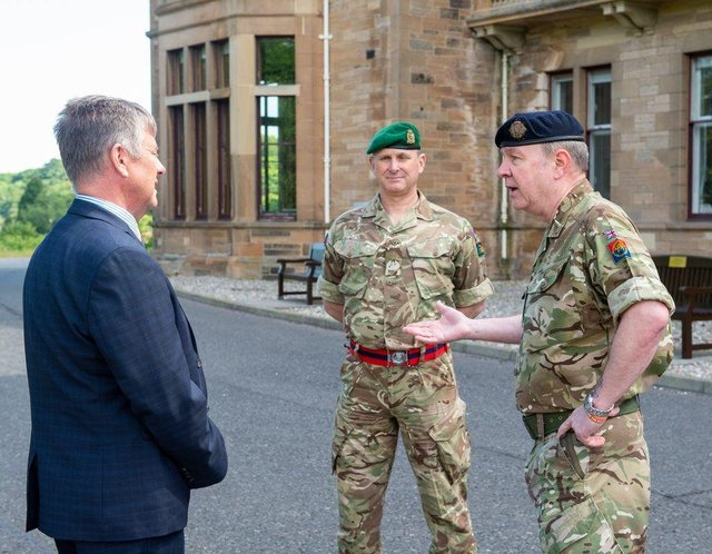 Keith BrownMSP, Cabinet Secretary for Justice and Veterans speaking to Personnel Recovery Officer Neil Davies and Officer Commanding Del Hamilton.