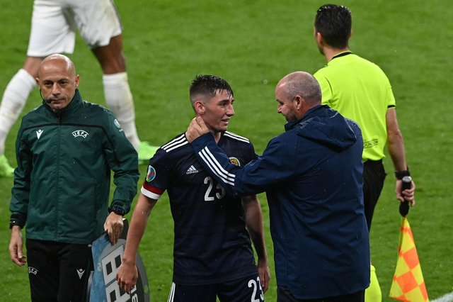 Scotland's midfielder Billy Gilmour (C) and Scotland's coach Steve Clarke (R) react after the UEFA EURO 2020 Group D  match between England and Scotland at Wembley. (Photo by FACUNDO ARRIZABALAGA/POOL/AFP via Getty Images)