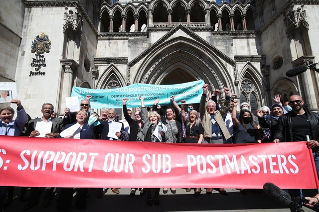 Former Post Office workers celebrate outside the Royal Courts of Justice in London, after their convictions were overturned by the Court of Appeal (Picture: Yui Mok/PA)