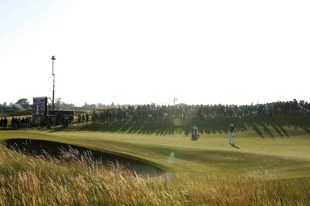 Open leader Louis Oosthuizen plays an approach shot on the 16th hole. Picture: Oisin Keniry/Getty Images