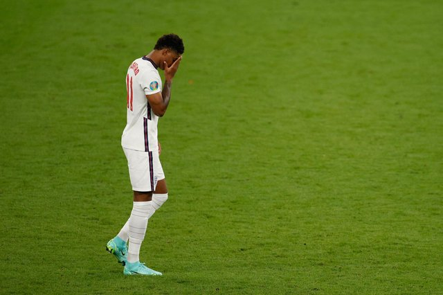 England's forward Marcus Rashford reacts after he fails to score in the penalty shootout during the UEFA EURO 2020 final football match between Italy and England at the Wembley Stadium in London. (Picture credit: John Sibley/Getty Images)