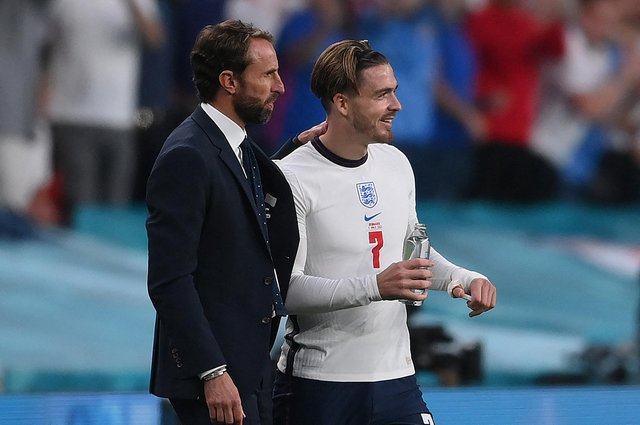 England manager Gareth Southgate (L) speaks with England's midfielder Jack Grealish (R) before the player was substituted on during the Euro 2020 semi-final win over Denmark. Grealish was later taken off again. (Photo by Laurence Griffiths / POOL / AFP) (Photo by LAURENCE GRIFFITHS/POOL/AFP via Getty Images)