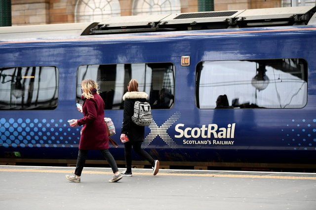 Two 12-year-old girls spent a night stuck on a train in Helensburgh after hiding from staff members.