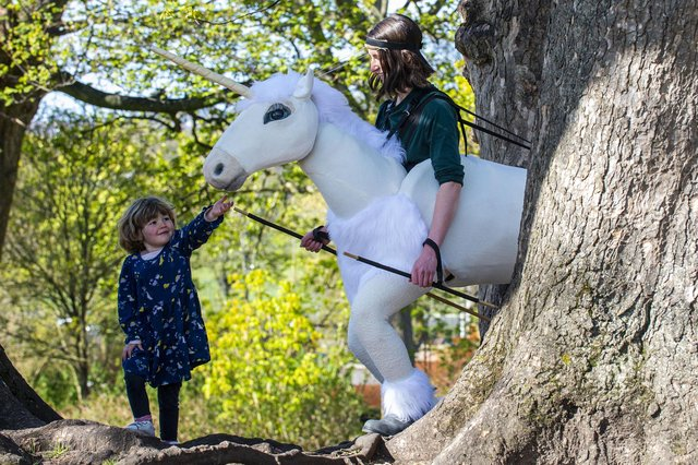 Four-year-old Rosa Kirby with The Unicon, who will be appearing in Family Encounters, the outdoors strand of this year's festival.