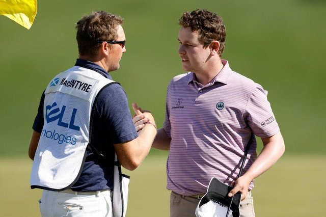 Bob MacIntyre celebrates with caddie Mike Thomson after winning his group in the World Golf Championships-Dell Technologies Match Play at Austin Country Club in Texas. Picture: Picture: Michael Reaves/Getty Images.