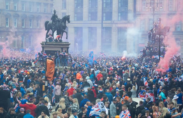 Rangers fans celebrate winning the title at George Square in Glasgow.