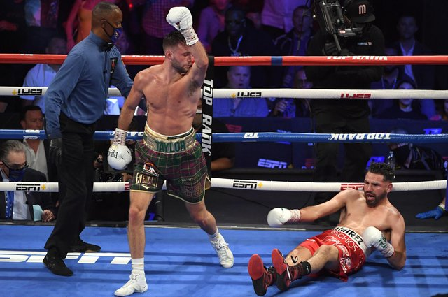 Josh Taylor reacts after knocking down Jose Ramirez en route to becoming the undisputed world super-lightweight champion. Picture: David Becker/Getty Images