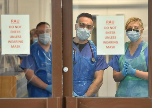 More than 150,000 NHS staff are being awarded an interim 1% pay rise.
