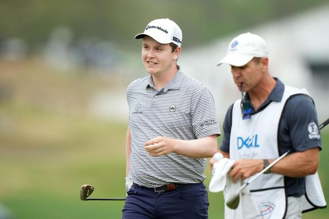 Bob MacIntyre flashes a smile after holing a bunker shot on the 16th in his match against Kevin Na on the opening day of the World Golf Championships-Dell Technologies Match Play at Austin Country Club in  Texas. Picture: Darren Carroll/Getty Images.
