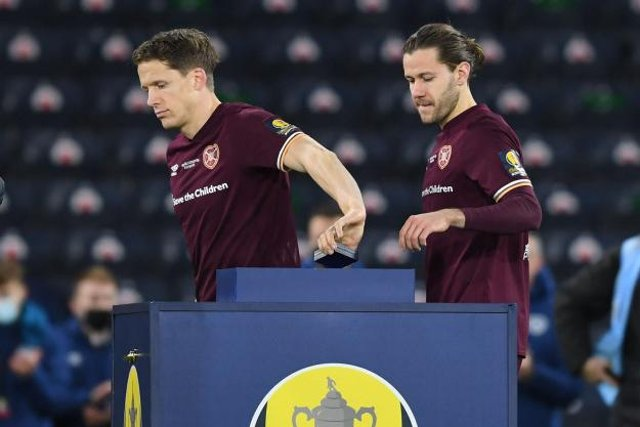 Hearts' Christophe Berra and Peter Haring collect runners-up medals after the William Hill Scottish Cup final (Photo by Craig Foy / SNS Group)