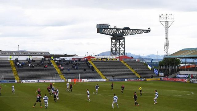 Morton supporters watch from the Wee Dublin End of Cappielow Park as their team defeat Airdrieonians in the Scottish Championship play-off final. (Photo by Ross MacDonald / SNS Group)