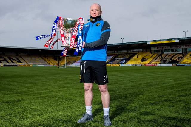 Livingston manager David Martindale holds the Betfred Cup prior to Sunday's final against St Johnstone. He revealed he will not be wearing a suit (Photo by Ross Parker / SNS Group)