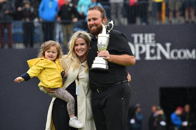 Shane Lowry celebrates with his wife Wendy and daughter Iris after his victory in last year's Open Championship at Royal Portrush. Picture: Getty Images