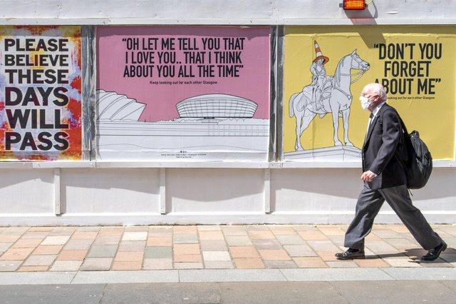 """Posters with the message """"keep looking out for each other Glasgow"""" and featuring song lyrics by Scottish artists such as Simple Minds, Dougie MacLean and Stealers Wheel have appeared around Glasgow city centre."""