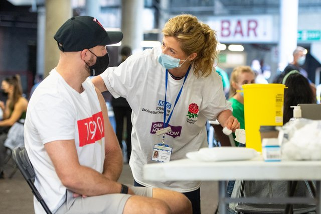 A man receives a vaccine at Twickenham rugby stadium in London on Monday, as a walk-in vaccination centre administered 15,000 doses to over 18s in the local area.