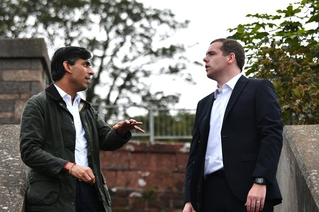 A bridge between parliaments? Douglas Ross, an MP and MSP, meets UK Chancellor Rishi Sunak at Wemyss Bay train station last year (Picture: John Devlin)