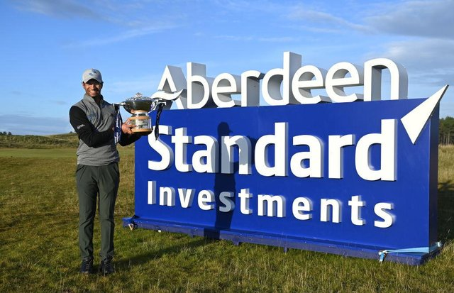 Aaron Rai poses with the trophy after winning the 2020 Aberdeen Standard Investments Scottish Open at The Renaissance Club. Picture: Ross Kinnaird/Getty Images.
