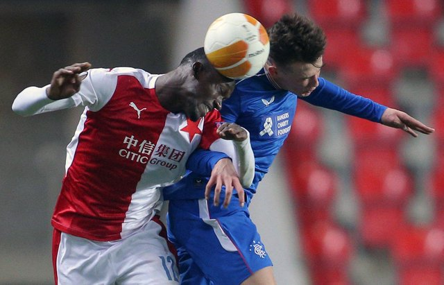 Slavia Prague's Senegalese forward Abdallah Sima (L) and Rangers' Scottish defender Nathan Patterson vie for the ball during the UEFA Europa League, last 16, first Leg football match Slavia Prague v Rangers at the Eden Arena stadium in Prague, Czech Republic, on March 11, 2021. (Photo by Milan Kammermayer / AFP) (Photo by MILAN KAMMERMAYER/AFP via Getty Images)