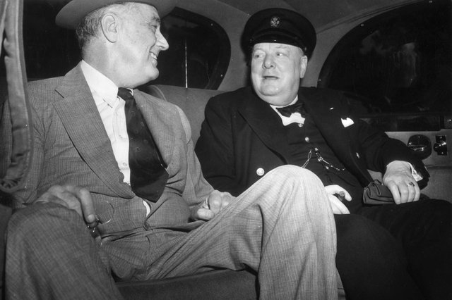 Winston Churchill and Franklin Roosevelt in a car on their way to the White House in Washington to discuss the Allied Victory in North Africa during the Second World War.   (Picture: Topical Press Agency/Getty Images)