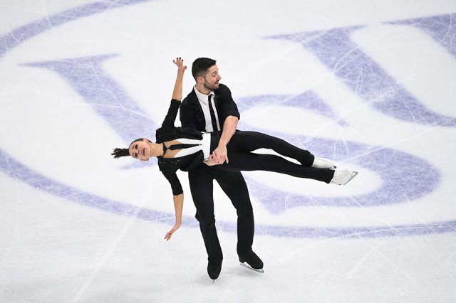 Great Britain's Lilah Fear and Lewis Gibson perform during the ice dance programme event at the ISU World Figure Skating Championships in Stockholm.