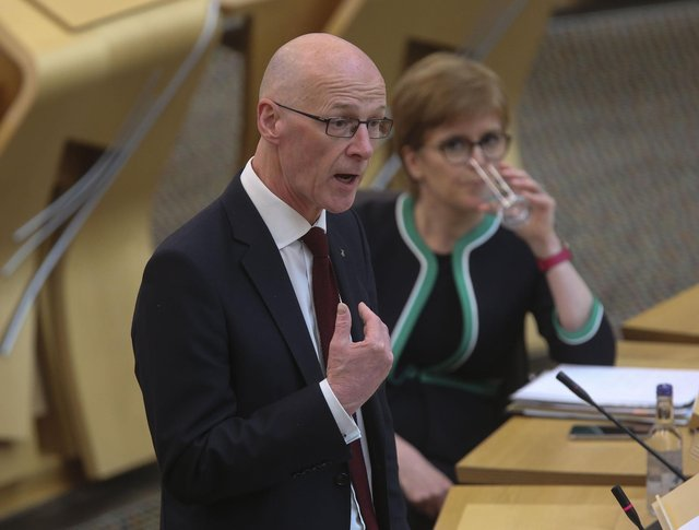 Nicola Sturgeon, seen looking on as John Swinney speaks in the Scottish Parliament, must be held to account by a strong opposition party over issues like poverty, says Susan Dalgety (Picture: Fraser Bremner/Scottish Daily Mail/via PA)