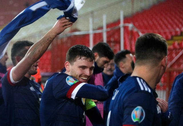 BELGRADE, SERBIA - NOVEMBER 12: Andy Robertson of Scotland celebrates with his team after his teams victory in the UEFA EURO 2020 Play-Off Final between Serbia and Scotland at Rajko Mitic Stadium on November 12, 2020 in Belgrade, Serbia. Football Stadiums around Europe remain empty due to the Coronavirus Pandemic as Government social distancing laws prohibit fans inside venues resulting in fixtures being played behind closed doors. (Photo by Srdjan Stevanovic/Getty Images)