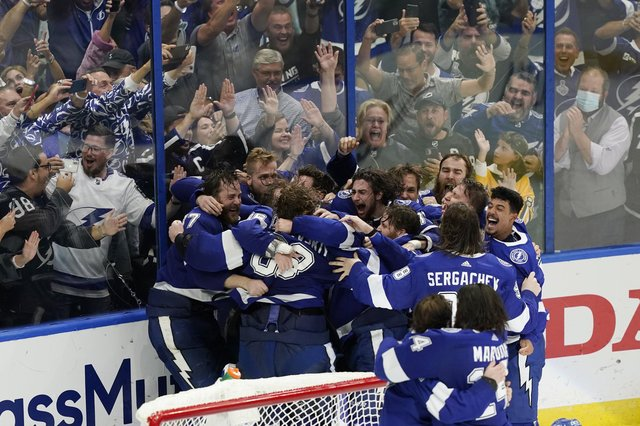 The Tampa Bay Lightning celebrate their series win over the Montreal Canadiens to retain the Stanley Cup in the NHL ice hockey finals. Picture: Gerry Broome/AP