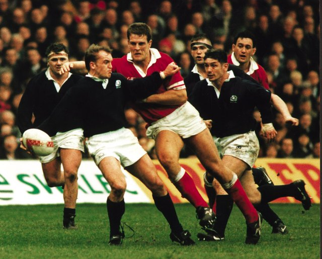 Gregor Townsend takes the brunt of the Welsh charge in the Scotland v Wales rugby game, 19 Feb 1996