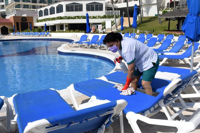 Which? is urging those considering a package holiday this summer to read the small print before booking. Picture: Elizabeth Ruiz/AFP via Getty Images.