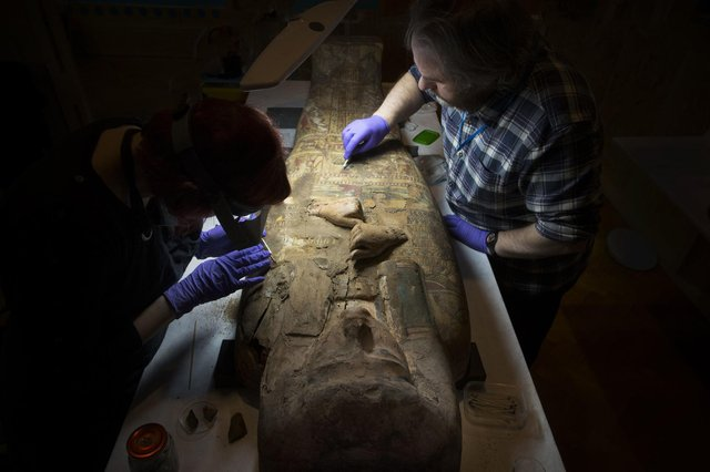 Conservators at Perth Museum and Gallery cleaning the 3000 old mummy Ta-Kr-Hb.