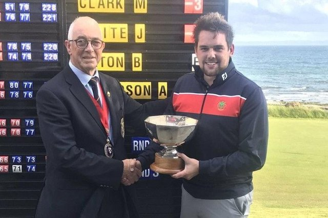 Stuart McLaren, who has since turned professional, receives the East of Scotland Open Trophy after his win at Lundin in 2019.