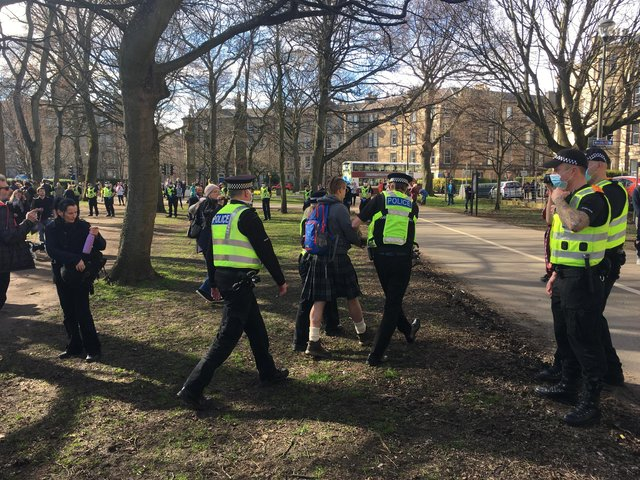 Police arrested five people during a large anti-lockdown protest in Edinburgh on Saturday.