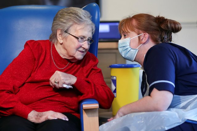 Resident Annie Innes, 90, talks with a healthcare worker at the Abercorn House Care Home in Hamilton.