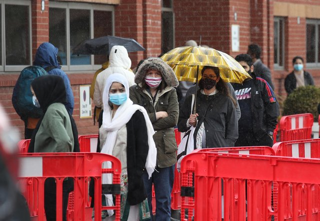 People queuing in the car park for a vaccination at the Glasgow Central Mosque in Glasgow. Glasgow and Moray remain in level three restrictions despite the rest of mainland Scotland moving to level two on Monday. Picture: PA