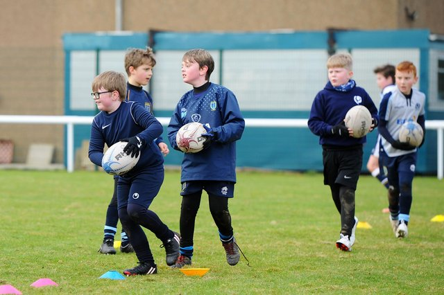 Taking part in sport at a young age helps to form habits that could save your life in later years (Picture: Michael Gillen)