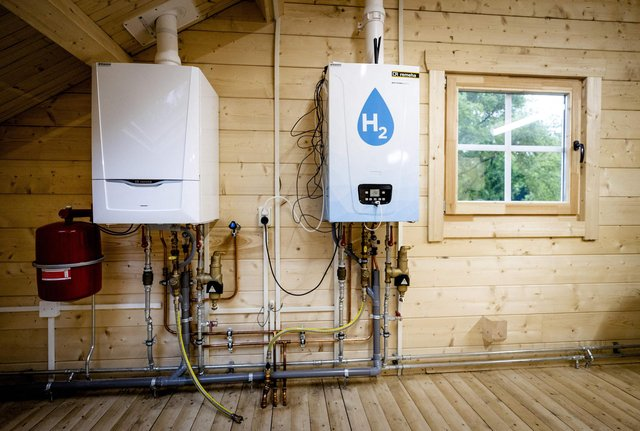 An old central heating boiler side-by-side with a hydrogen boiler (Picture: Sem van der Wal/ANP/AFP via Getty Images)