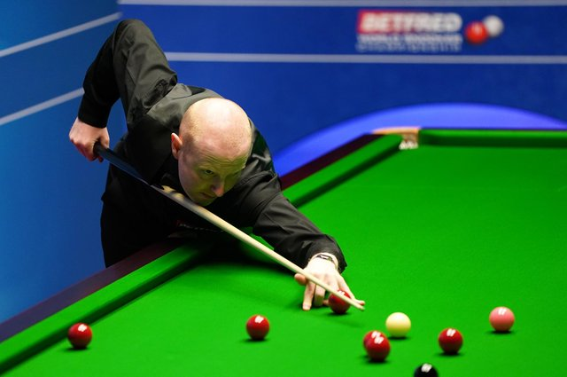 Anthony McGill in action in yesterday's gripping contestat theCrucible Theatre, the Scot losing in a final-frame decider. Picture: Zac Goodwin/Getty