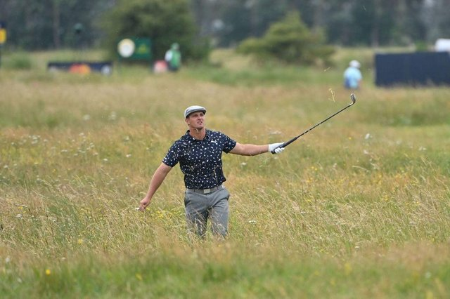 Bryson DeChambeau plays out of the deep rough on the 15th hole during the first round of the 149th Open at Royal St George's. PIcture: Picture: Paul Ellis/AFP via Getty Images.