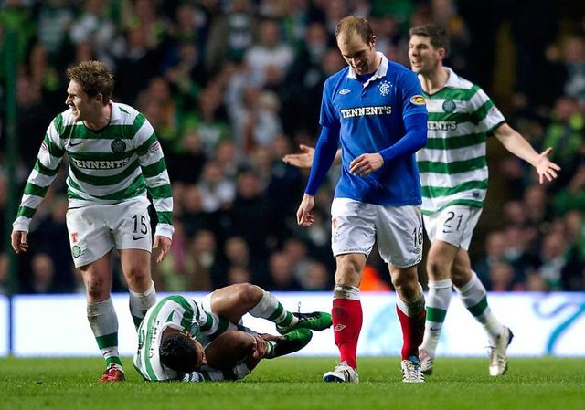 Rangers' Steven Whittaker is sent off after receiving his second yellow card for a foul on grounded Celtic full-back Emilio Izaguirre. (Photo by Craig Williamson/SNS Group).