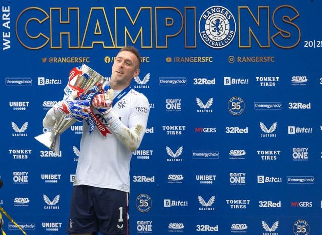 Rangers goalkeeper Allan McGregor gets his gloves on the Premiership trophy at Ibrox at the end of last season. (Photo by Craig Williamson / SNS Group)