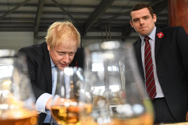 Boris Johnson and Scottish Conservative leader Douglas Ross, seen at the Roseisle Distillery, need to focus on conveying a sense of purpose and of a UK which will deliver and deliver fast, says John McLellan (Picture: Stefan Rousseau/PA)