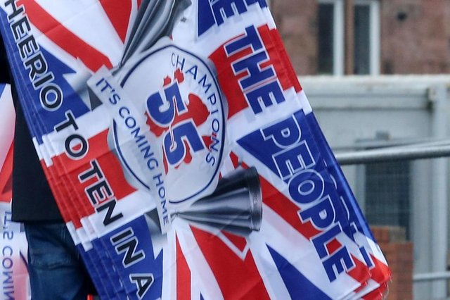 A woman has been seriously injured in an attack by another woman who was draped in a Rangers FC flag. Picture: Robert Perry/PA Wire