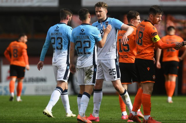 The Ross County players celebrate at full time after defeating Dundee United 2-0.