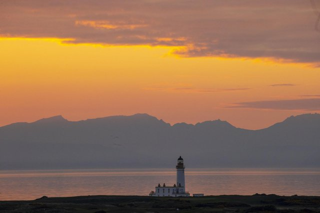 A glowing sunset was captured on the coast behind Ayrshire's scenic Turnberry Trump golf course