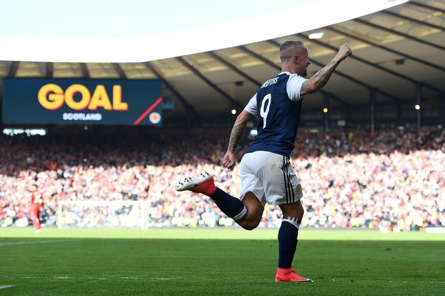 One of the great moments in Auld Enemy clashes, Leigh Griffiths celebrating the second of his free-kick goals in 2017 which could have, should have, brought us victory