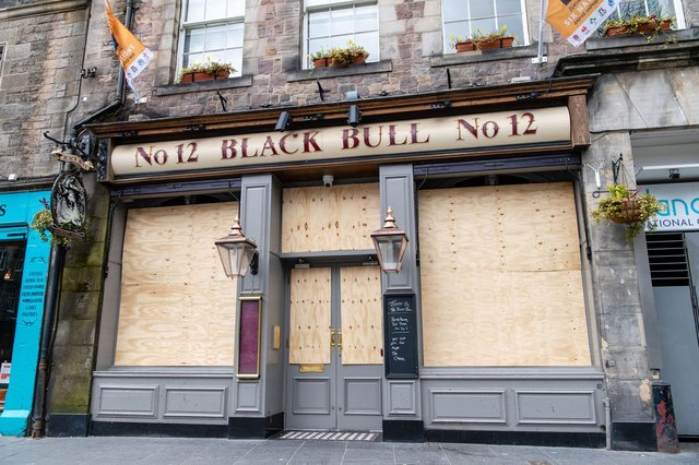 The Black Bull in Grassmarket, Edinburgh, is one of the many pubs in the city to be boarded up during the pandemic