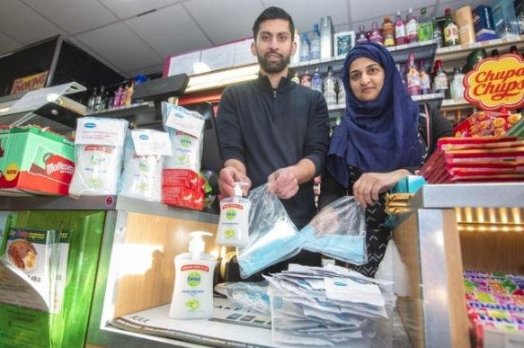 Asiyah Javed, 34, and her husband Jawad, 35, run the Day Today Express convenience store in Stenhousemuir, Falkirk.