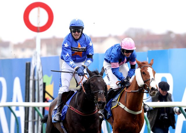 Mighty Thunder ridden by Tom Scudamore (left) wins the Coral Scottish Grand National Handicap Chase during the Coral Scottish Grand National Day at Ayr Racecourse. Picture: Jeff Holmes/PA Wire