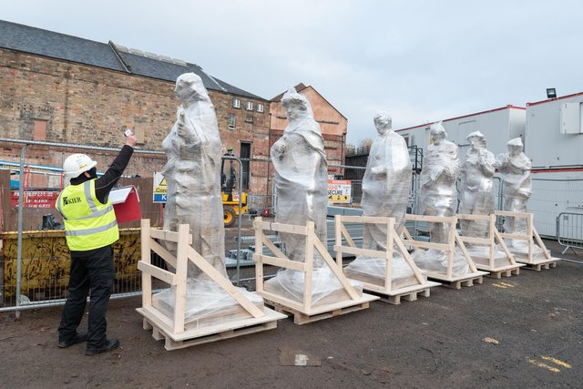 The statues have returned to the Citizens ahead of being lifted onto the top of the venue.