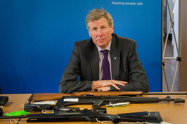 15th May 2014. Justice Minister Kenny MacAskill with air guns which have been handed into the police by responsible owners. The guns in the wrong hands could be used for crime. Credit Steven Scott Taylor.